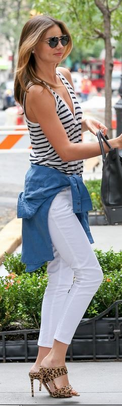 Miranda Kerr: Shirt – T by Alexander Wang  Shoes – Miu Miu  Purse – Hermes  Sunglasses – Prada  Shirt – Burberry