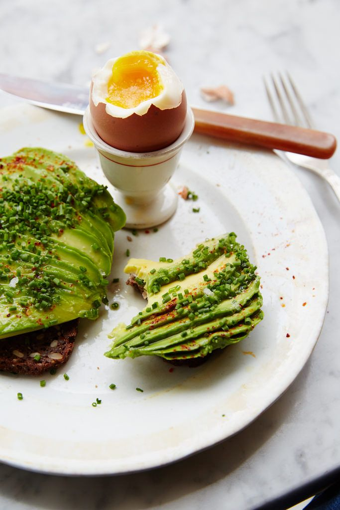 """Typical Danish lunch or brunch. Avocado on ryebread (""""rugbrød"""") with a soft-boiled egg <3 Oh, and then of course on a Royal Copenhagen plate.."""