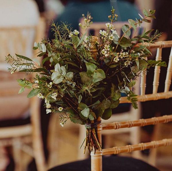 Evergreens Decorated Chair For Winter Wedding