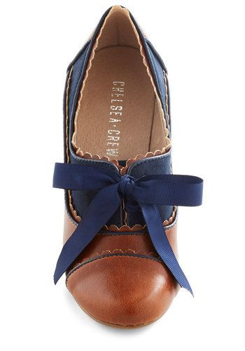 Adorable! ModCloth Oxford Shoes, navy and warm brown oxford with blue bow detail, super feminine and comfy  Look at these adorable shoes! I could just imagine myself traipsing down the streets of Montreal in these beauties!
