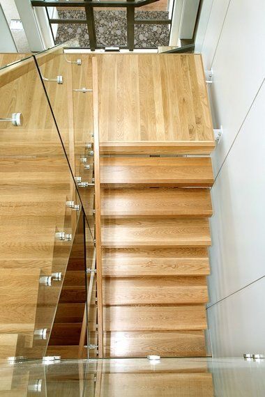 Steel Stair with American Oak treads and frameless glass balustrade
