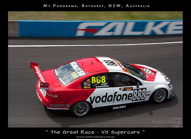 Craig Lowndes in the special Peter 'Brocky' Brock livery car for the 50th anniversary of the great race. Here he flies through Forrest Elbow on Mt Panorama during the Bathurst 1000 V8 Supercar race - taken Oct 2012, Bathurst, NSW As a photographer I have a passion for photographing the V8 supercars.