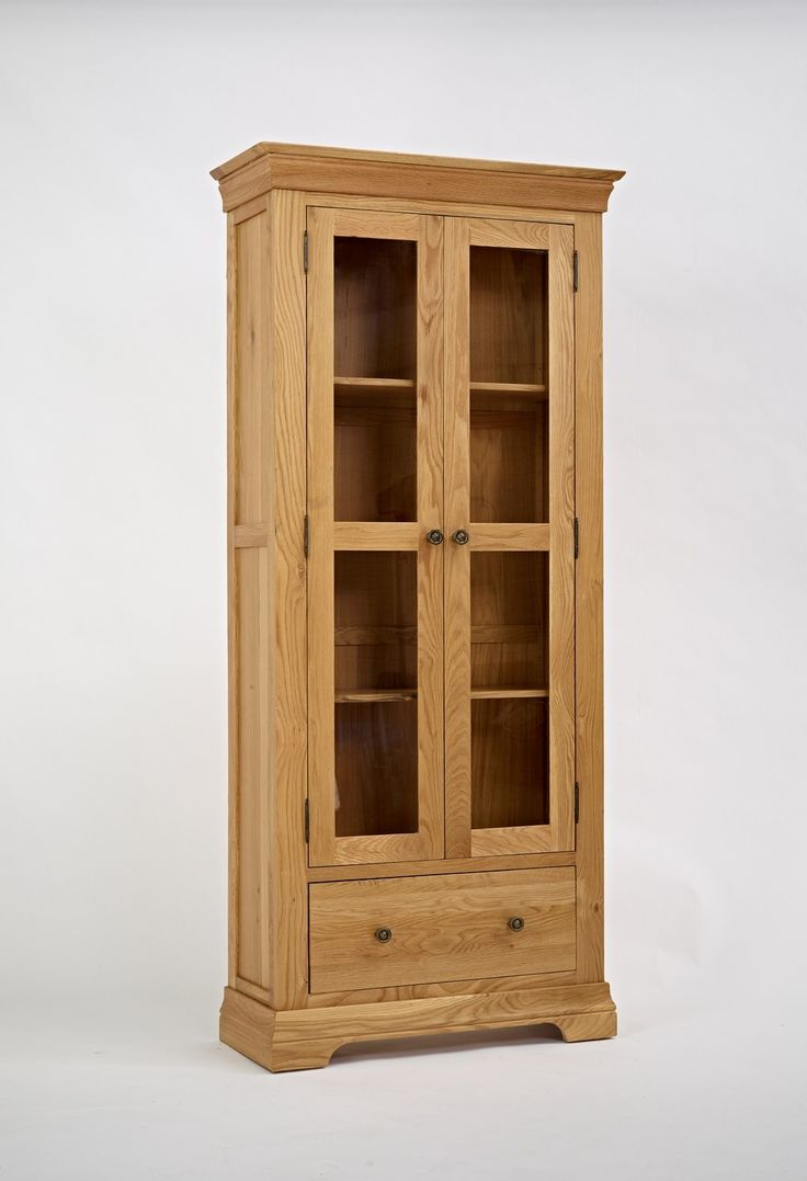 Normandy Oak Display Cabinet - With smooth curves and an elegant style with sophisticated metal knob handles, this collection is crafted to exceptional techniques with attractive features such as dovetailed drawers and plinth detailing.
