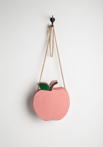 Thrilled to Peaches Bag. Nothing lifts your spirits quite like swinging this quirky crossbody bag over your shoulder! #pink #modcloth