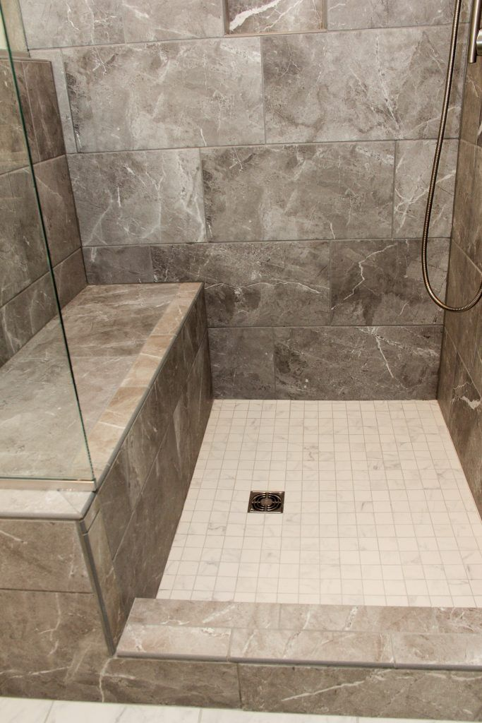 Carbon Gray Tiled Shower With Bench And White Square Tile Shower