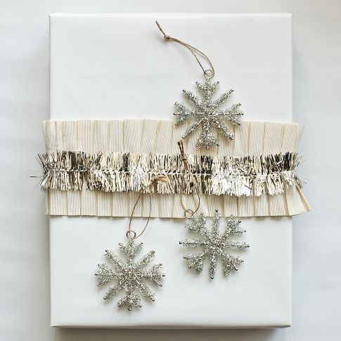 Tinsel Snowflake Ornaments...would be a fun & inexpensive DIY project with metallic pipe cleaners from the craft store