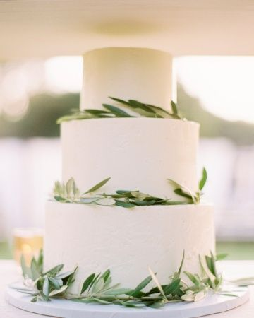 Wedding Cakes. Olive branches add some greenery to this buttercream wedding cake