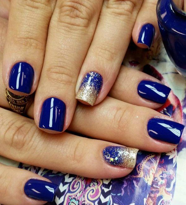 Blue themed washed out gradient nail art design. A rather artsy display of gradient using gold glitter polish gradually declining inwards the nails. Dark blue polish is used as the base coat for this little number.