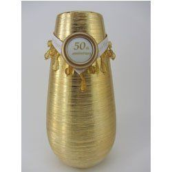 Modern 50th Anniversary Vase - Gold Vase for 50th Anniversary Centerpiece by Jubilee Celebrations by Wellhaven. $19.99. Ceramic gold vase has a striated design in shiny gold. Beaded ribbon reads:  50 Years Together. Display at 50th anniversary party and at home.. Size: 7.5 inches tall x 3.5 inches at its widest point. Ribbon lays on vase - can be removed easily to use vase everyday. The modern 50th anniversary vase is a stylish 50th wedding anniversary centerpiece...