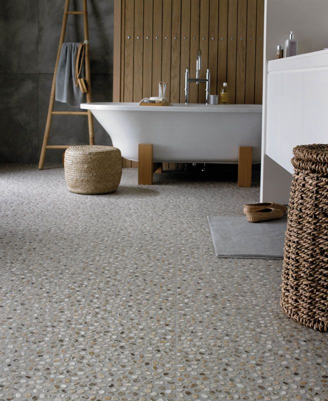 Karndean Flooring shown here in Navarra Chalk. Achieve the soft texture of smooth raised pebbles under your feet with none of the porosity, roughness or wear associated with real sand and stone poured flooring.