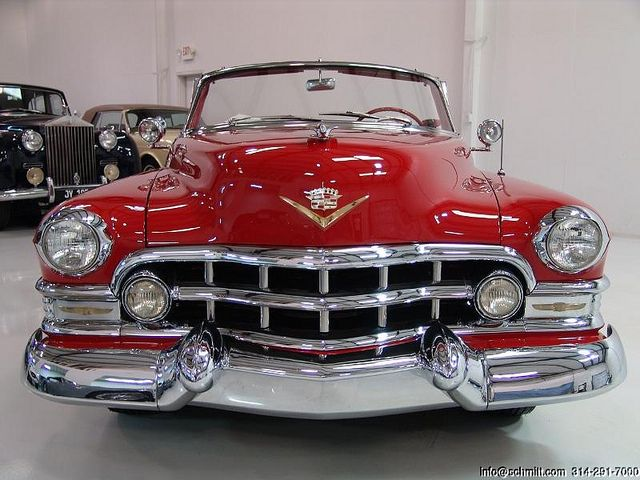 Cadillac 1952.....BIG....RED....SHINNY....and a FACE FULL OF CHROME
