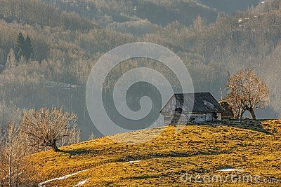Traditional Romanian old wooden hut on a sunny morning, uphill in Moeciu, Brasov county, Romania. - Download From Over 28 Million High Quality Stock Photos, Images, Vectors. Sign up for FREE today. Image: 48956606