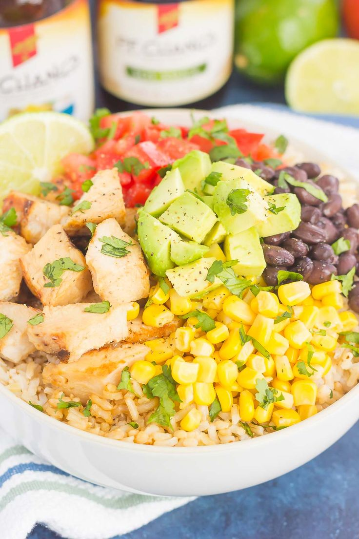 Skip the takeout and make your own Easy Chicken Burrito Bowl at home!It'sloaded withjuicychicken, cilantro lime rice, black beans, corn, freshtomatoes, and avocado. Drizzled with a soy sauce marinade and ready in no time, this meal is sure to become a family favorite!