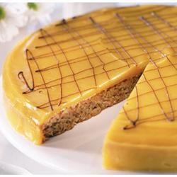 Norwegian Almond Cake... A light almond cake with a rich custard topping. Not a pretty cake, but never met a person who didn't like it. However, be careful - not all the ingredients are good for the waistline... Original recipe makes 10 servings...