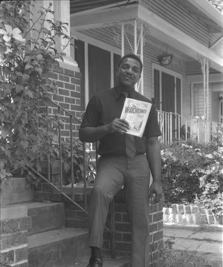 Huey Smith in front of his New Orleans home, holding a copy of the Jehovah's Witnesses publication, The Watchtower, circa 1973. Photo courtesy of the Tad Jones Collection, Hogan Jazz Archive, Tulane University.