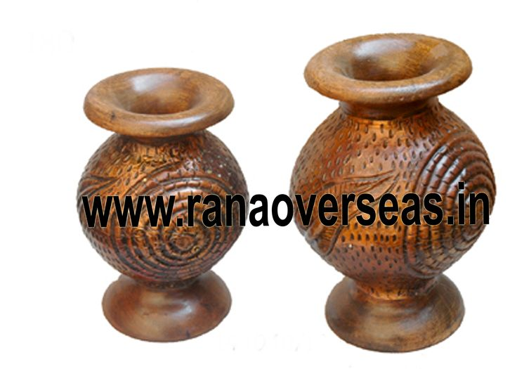 Rana Overseas leading manufacturer, exporter and supplier of Wooden Flower vases.Wooden flower vases designed by artist beautifully showcase the traditional as well as modern designs. Wooden Flower vases are designed in styles ranging from exquisite to outrageous ones. These Flower vases chiseled out of variety of materials in varied shapes are extremely eye-catching with their compelling beauty. The Wooden flower pot base is made heavy to provide support to its body.