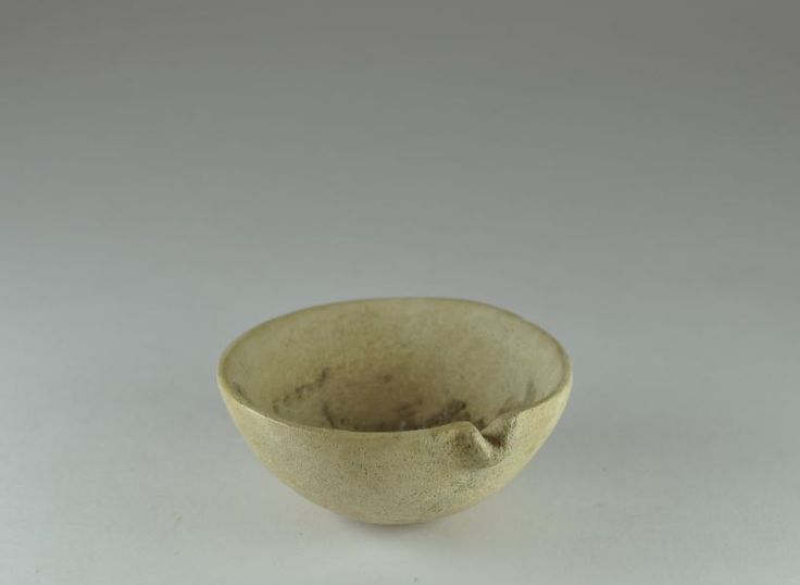 Libation vase, Syrian Levantine stone spouted vessel, 2nd millenium B.C. Libation vase, Syrian Levantine stone spouted vessel, stone ritual libation bowl with short pouring spout, 6 cm diameter. Private collection