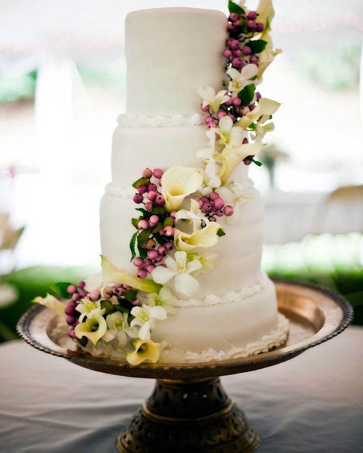 This four-tier buttercream-covered cake was made by Scott Jeffries of Merriweather Godfrey's in Lynchburg, Virginia, and featured a wrap of calla lilies and berries. It was served on an antique bronzed cake platter at the reception.