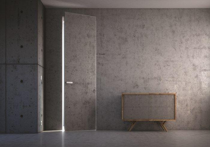 PIU Design: wysokie drzwi wykończone betonem architektonicznym, wykonane w technologii Aluminium Design