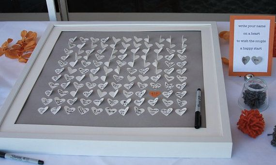 """Guest book option then frame for a modern art display for the house. """"write your name on a heart to wish the couple a happy start."""""""