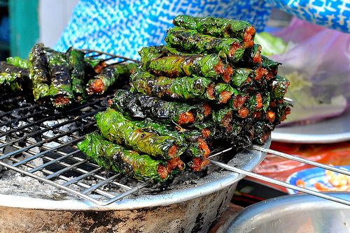 Bo La Lot, is seasonned ground beef wrapped in betel leaf grilled.They can be eaten in a similar manner to spring rolls as an entree or with vermicelli and nuoc cham.