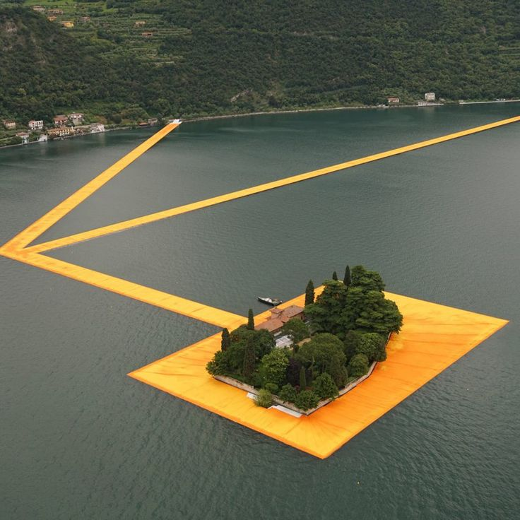 Three kilometres of saffron-coloured pathways temporarily connected the shore of Italy's Lake Iseo to islands at its centre in this installation by Bulgarian artist Christo.