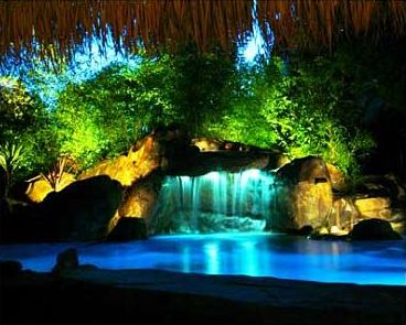 Rock formations you can jump off of with waterfalls you - Swimming pool fountains and lights ...