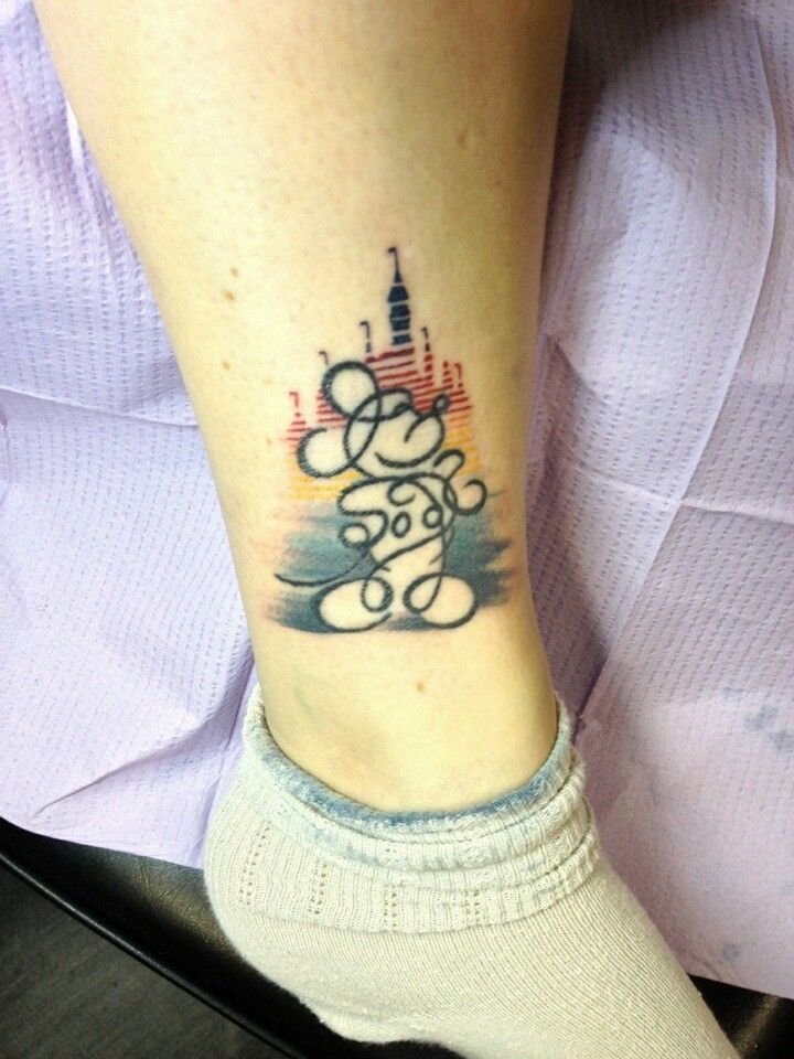 Mickey Mouse sketched Califgraphy tattoo with 30th Anniversary 1985 Disneyland Castle in background.