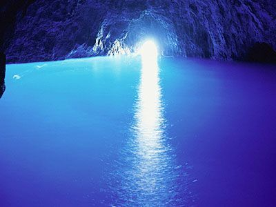 Blue Grotto, Italy,  The Blue Grotto is a spectacular accident of nature. Found on the Italian island of Capri, this soft limestone cave is suffused by an eerie blue light. The light comes from another underwater entrance to the cave and is reflected off the white cave floor. Roman emperors supposedly used the grotto as a private bath.: Favorite Places, Beautiful Places, Caves, Places I D, Travel, Capri Italy, Blue Grotto Capri, Italy