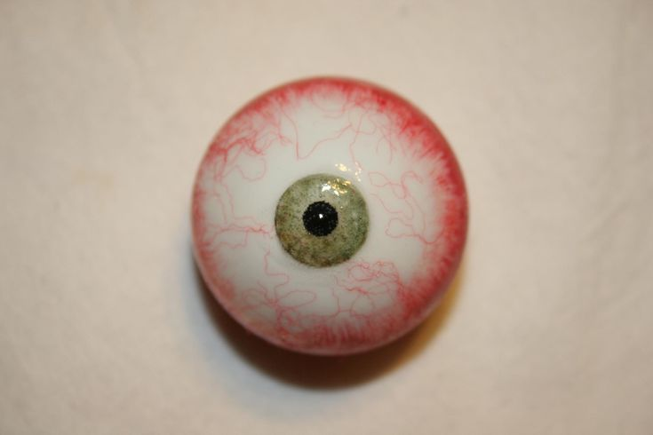 make your own scary eyes out of ping pong balls and red yarn fibers