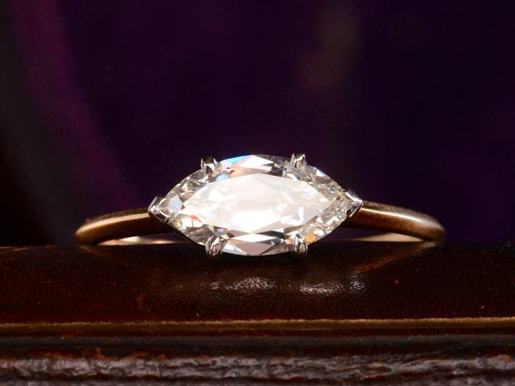 1.03 carat east-west marquese with antique gold band and minimal platinum prong setting. Good lord <3