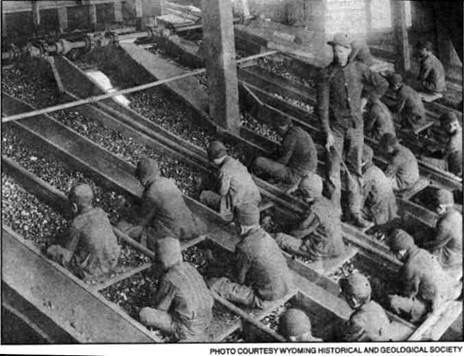 Breaker Boys- picking out the impurities in coal by hand-the adult has a whip in his hand & these boys are so young!--IMWVCT