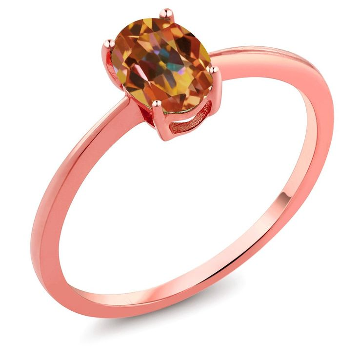 0.80 Ct Oval Ecstasy Mystic Topaz 10K Rose Gold Ring. This item is proudly custom made in the USA. 100% Satisfaction Guaranteed. Gemstones may have been treated to improve their appearance or durability and may require special care.