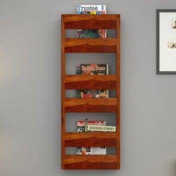 Buy #Alnus #Magazine #Rack (Honey Finish) online at Wooden Street. Magazine racks are available in various dazzling designs that gives amazing look to your home or office. Place your order now for stylish wooden magazine racks. Visit : https://www.woodenstreet.com/magazine-rack