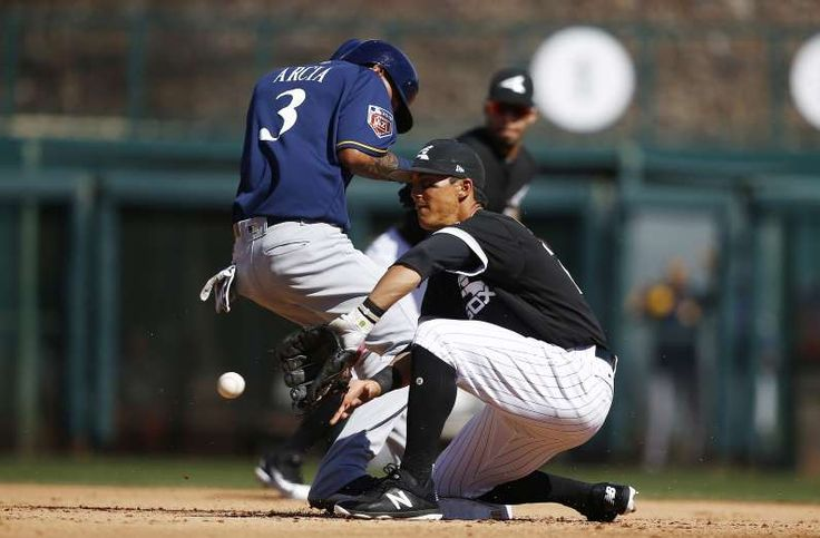 2018 MLB spring training - EVASIVE ACTION:  The White Sox' Tyler Saladino, right, waits for a late throw as the Brewers' Orlando Arcia gets back to second base safely on March 6 in Glendale, Ariz. Chicago won 6-4.