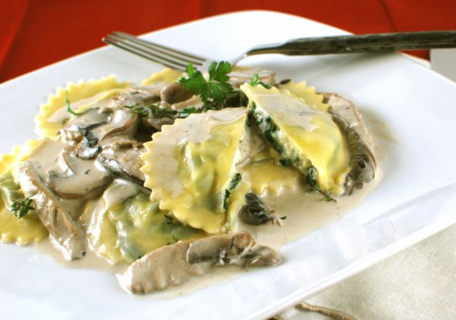 Recipe; Goat Cheese and Spinach Ravioli with Creamy Mixed Mushrooms;Ravioli Filling  4 oz goat cheese-  4 oz fresh ricotta-  1 egg-  3.25 oz cooked spinach (5 oz raw)-  .25 tsp nutmeg-  salt and pepper- Pasta Dough Recipe-  2 cups all-purpose unbleached flour-  2 eggs-  1 Tbsp olive oil-  1/2 tsp salt-  ~