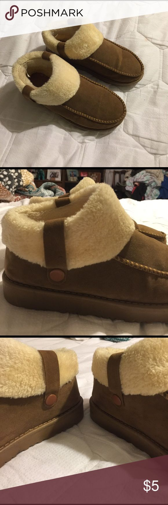 Brown faux fur and suede moccasin booties Cute brown faux fur and suede mocassin booties. Keep feet extra warm in the winter months. Worn once. Size 38 in European, fits like size 7 in US. Shoes Winter & Rain Boots