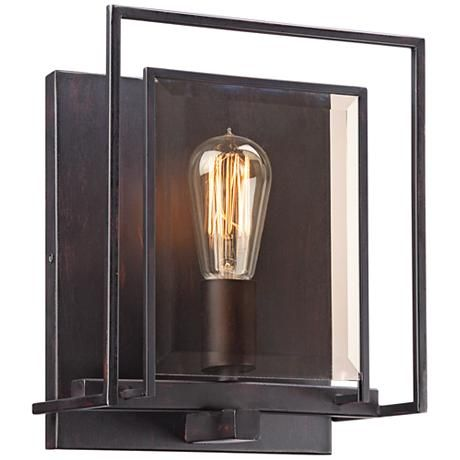 This industrial inspired wall sconce pairs a bronze finish with amber beveled glass panels for a striking look full of dimension.