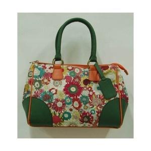 Bolso de asas verdes y estampado de flores de Quintana.