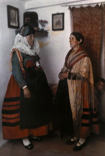Two young women pose in costumes of Old Castile. Segovia, Spain. Gervais Courtellemont. National Geographic before 1924