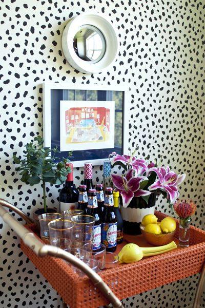 Would be so fun in my closets...   Black & white wallpaper by @Thibaut Abou Mrad ( Anniversary Collection, Tanzania) & orange @RoxyTeOwens // SocietySocial bartcart!