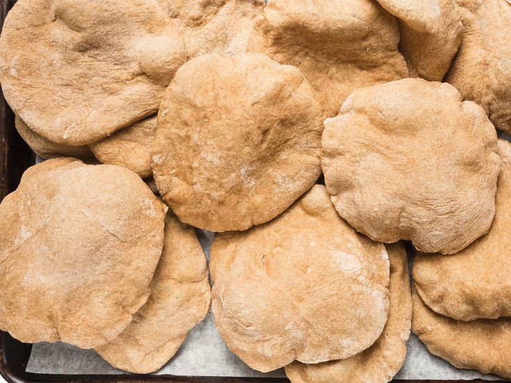 Egyptian Flatbread (Aish Baladi)Ingredients 1 tbsp. active dry yeast 2 1⁄2 cups water, heated to 105º 5 cups whole-wheat flour, plus more for dusting 1 shot kosher salt 1 tbsp. vegetable oil, plus more for greasing Cracked wheat bran for proofing, optional