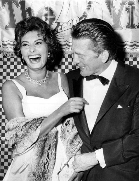Sophia Loren & Kirk Douglas 1958; quite important to keep smiling