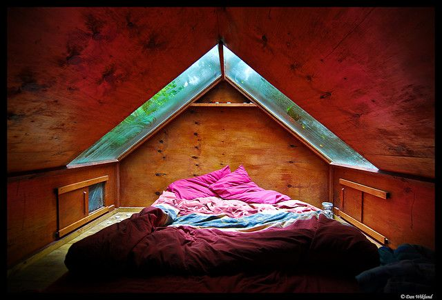 """Interior of the """"Stargazer"""" cabin features 2 large skylights / windows over the bed.  Photo by Dan Wiklund."""