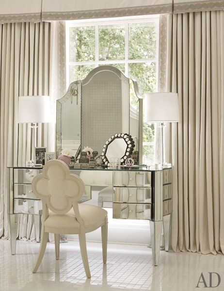 The dressing table in the master bath is by Nancy Corzine, as is the mirror; the chair is a Kasler design for Hickory Chair.: