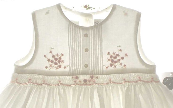 Sarah Louise Ivory Smocked Sleeveless Dress with Pintucks and Peach Rosebuds Good idea for IzzieB. For a summer top.