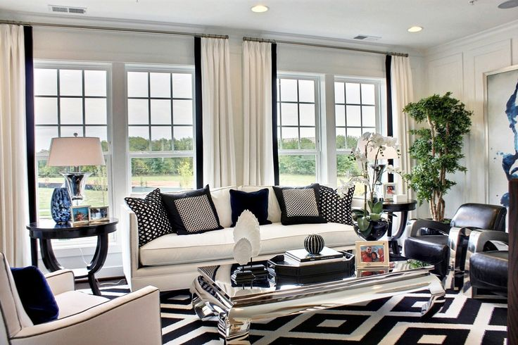 The black and white color theme adds to the grandeur of the double-height living area. Description from faburous.com. I searched for this on bing.com/images