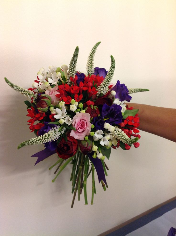 Contrasting hot colours, bouvardia, lisianthus, veronica and avalanche rose