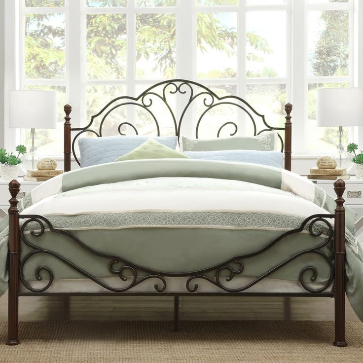 dark brown polished wrought iron bed frame having curved headboard placed in front of white stained - Cast Iron Bed Frame