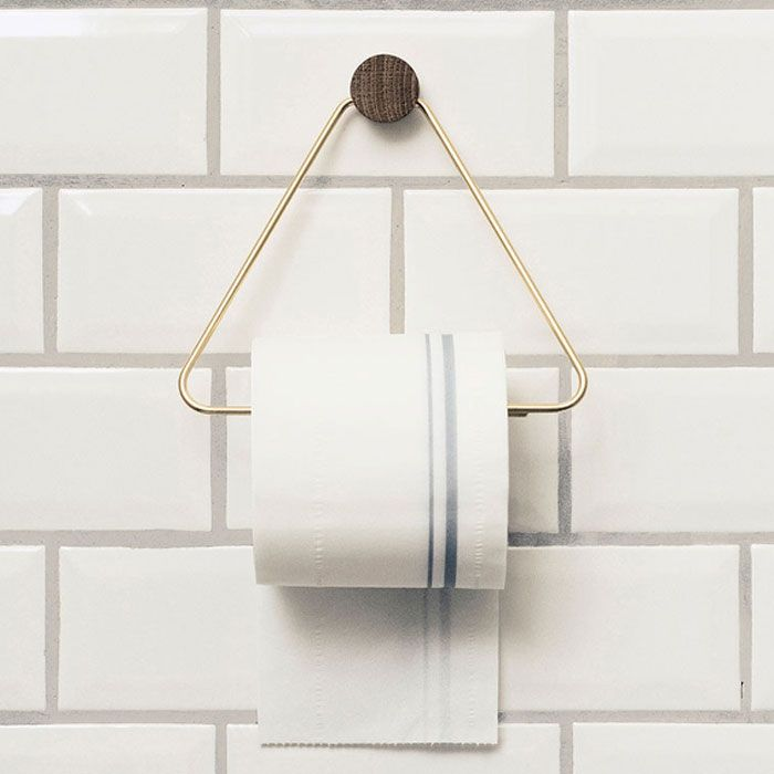 This sophisticated Brass Toilet Paper Holder by Ferm Living puts a Scandinavian-style twist on a bathroom accessory that is usually dull and boring.